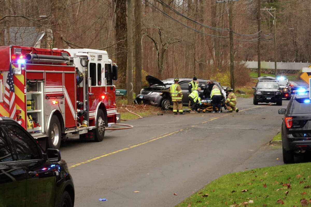 Police, firefighters and EMTs responded to Ponus Ridge near Frogtown Road after a driver fleeing police crashed around 2 p.m. Wednesday, Dec. 2.