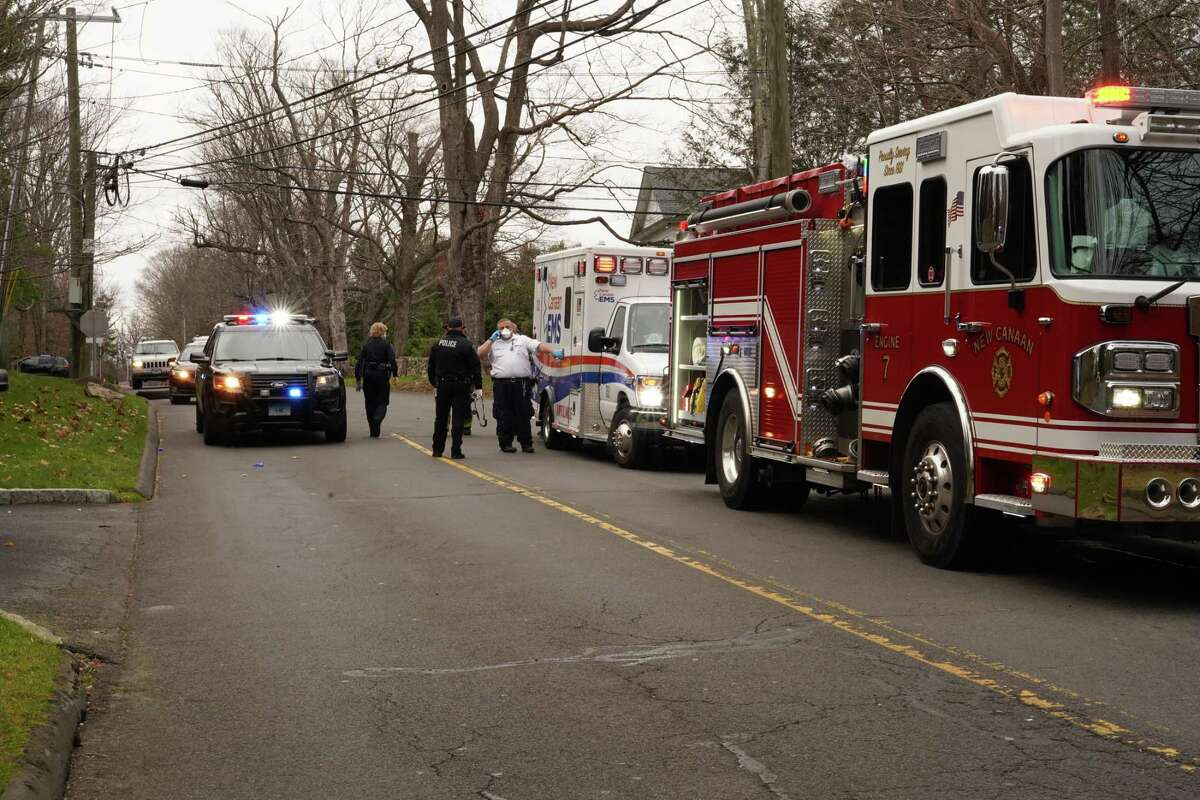 Several vehicles including an ambulance, New Canaan Fire Department trucks and New Canaan Police vehicles gather near the corner of Ponus Ridge and Frogtown Road after a crash involving a driver allegedly fleeing police Wednesday, Dec. 2.