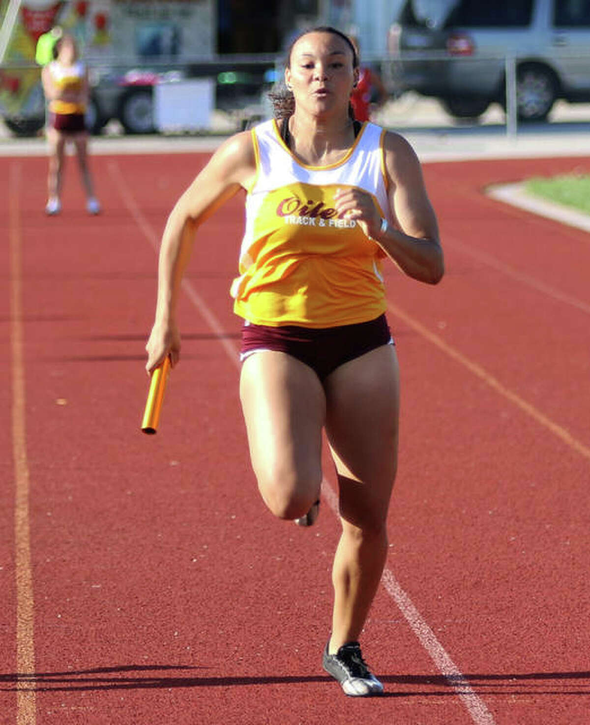 EA-WR's Jayden Ulrich runs the anchor leg in the Oilers' 4x100 relay at the 2019 Prairie State Conference Meet in Wood River. Ulrich, now a senior, has since given up her sprint duties to concentrate on the throws for EA-WR track.