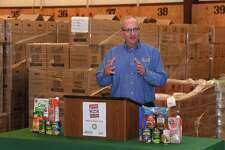 Dan Maher executive director of the Southeast Texas Food Bank talks about the organization's partnership with the US Postal Service to conduct the Stamp Out Hunger food drive this Saturday. The drive allows area residents to place non-perishable foods next to their mailbox on Saturday for carriers to collect for the food bank. Officials said under poor weather conditions, participants could place food items in a plastic bag or donate Monday. Photo taken Thursday, 5/9/19