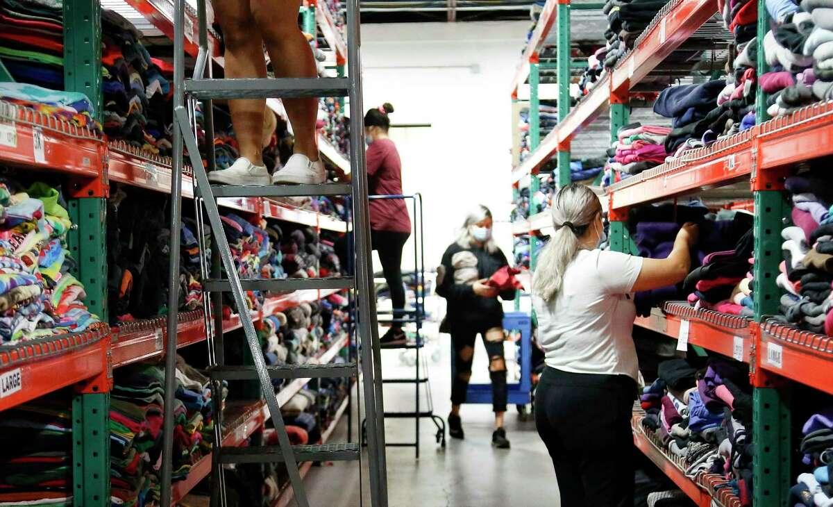 Goodfair employees pull orders for the Houston-based online thrift store on Wednesday, Sept. 30, 2020.
