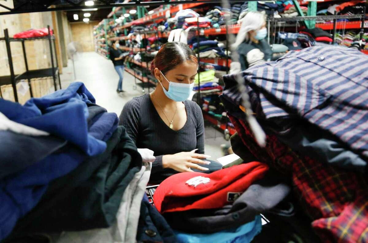 Giselle Jimenez pulls orders for Goodfair, a Houston-based online thrift store.