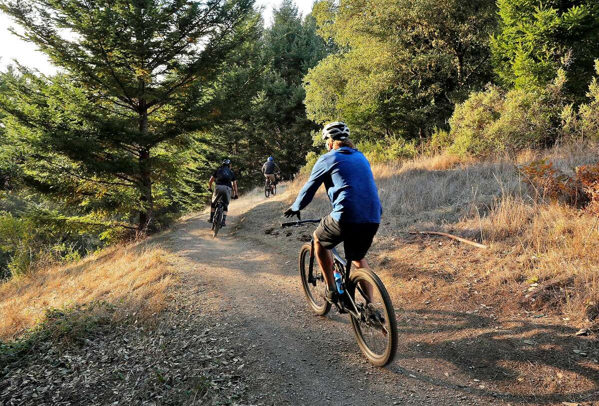 Bikers take advantage of the dry weather at El Corte de Madera Creek Open Space Preserve in San Mateo County.