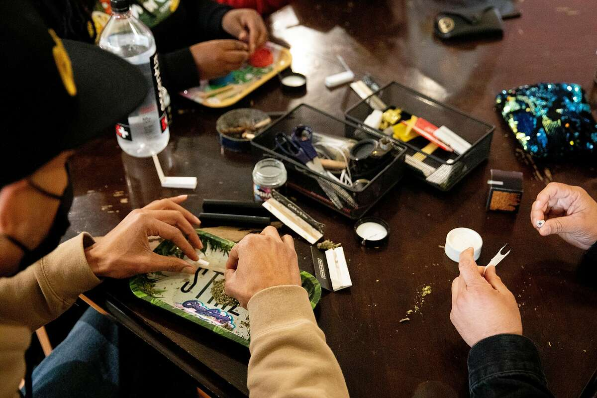 Showboat (left) and Ivan Castro wear masks while rolling joints at the Berner's on Haight dispensary.