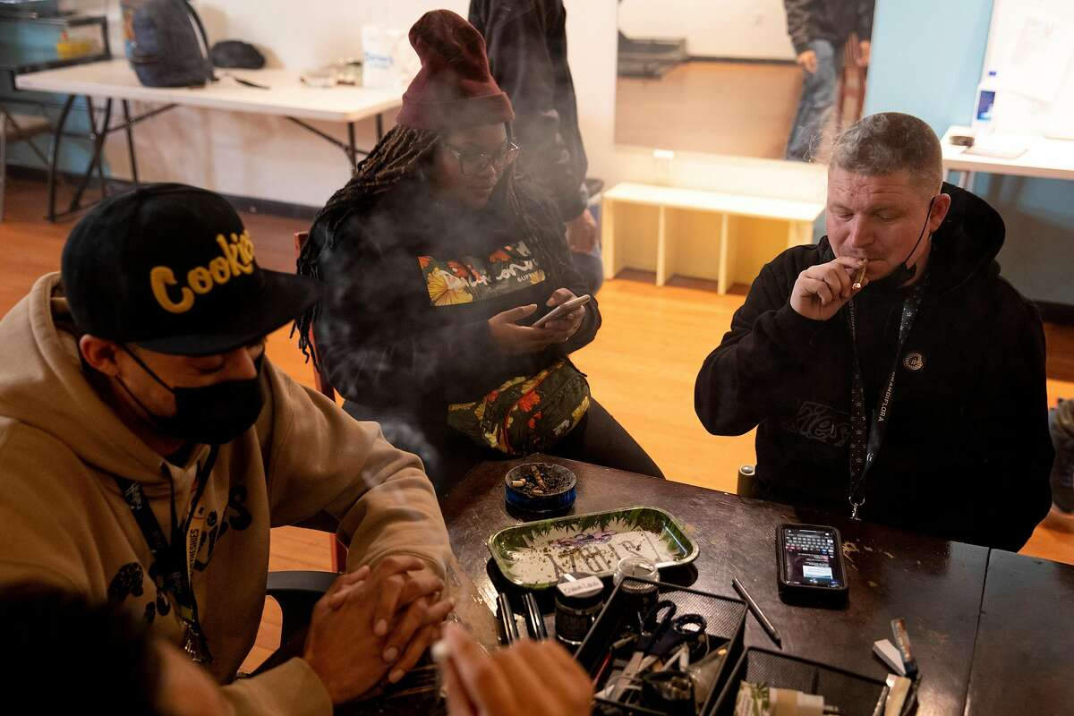 Ivan Castro (left), Showboat, Shawna Richards, and Kevin Tevin sit in the smoking room of Berner'' on Haight.
