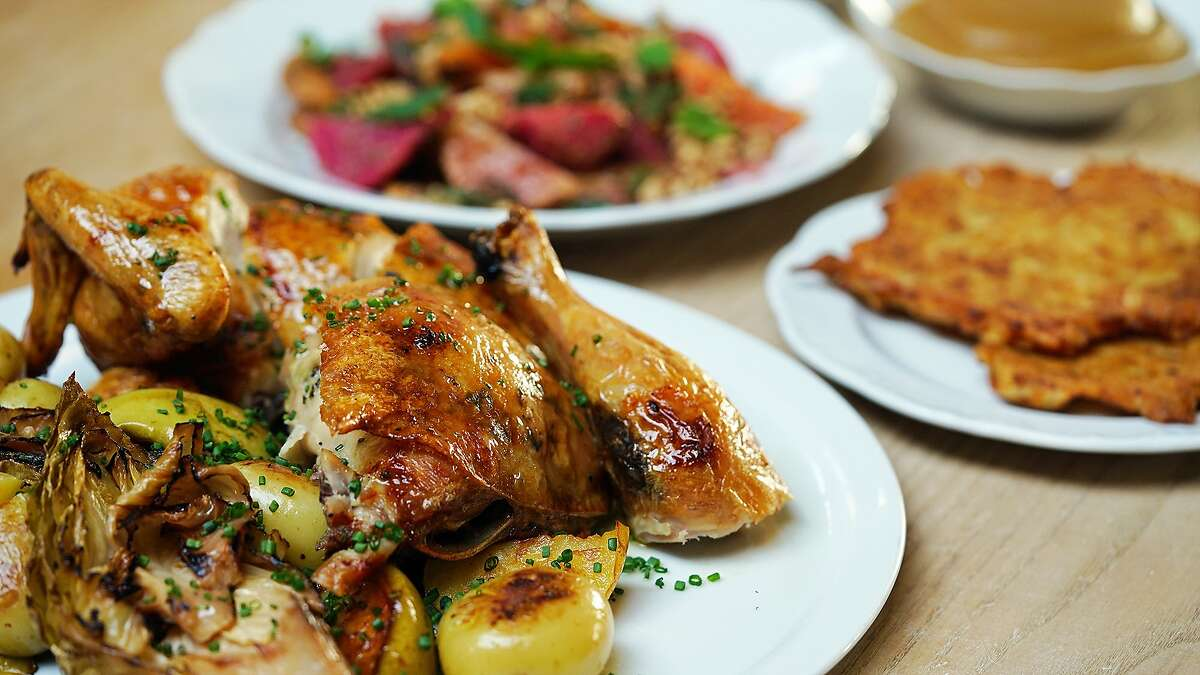 A whole roasted chicken with cabbage and apples is the entree for Che Fico's Hanukkah spread.
