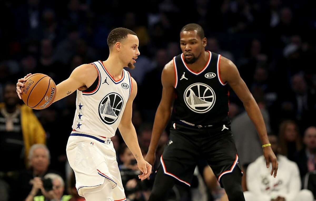 CHARLOTTE, NORTH CAROLINA - FEBRUARY 17: Kevin Durant #35 of the Golden State Warriors and Team LeBron defends Stephen Curry #30 of the Golden State Warriors and Team Giannis during the NBA All-Star game as part of the 2019 NBA All-Star Weekend at Spectrum Center on February 17, 2019 in Charlotte, North Carolina. NOTE TO USER: User expressly acknowledges and agrees that, by downloading and/or using this photograph, user is consenting to the terms and conditions of the Getty Images License Agreement. (Photo by Streeter Lecka/Getty Images)