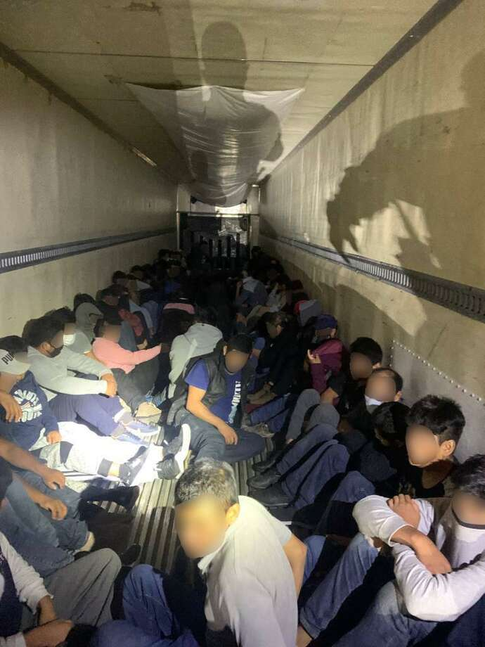 U.S. Border Patrol agents said they discovered these 86 people in the back of a trailer. All were determined to be immigrants who had crossed the border illegally. Photo: Courtesy Photo /U.S. Border Patrol