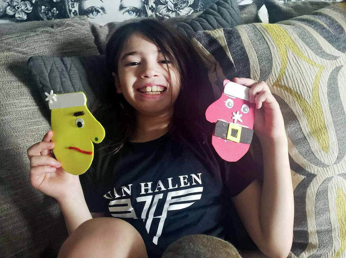 """Branford's Macey Flores, 8, with her """"Macey's Mittens for Kittens"""" a fundraising effort to benefit the Branford Compassion Club. These cute decorated cardboard mittens have raised $900 so far."""