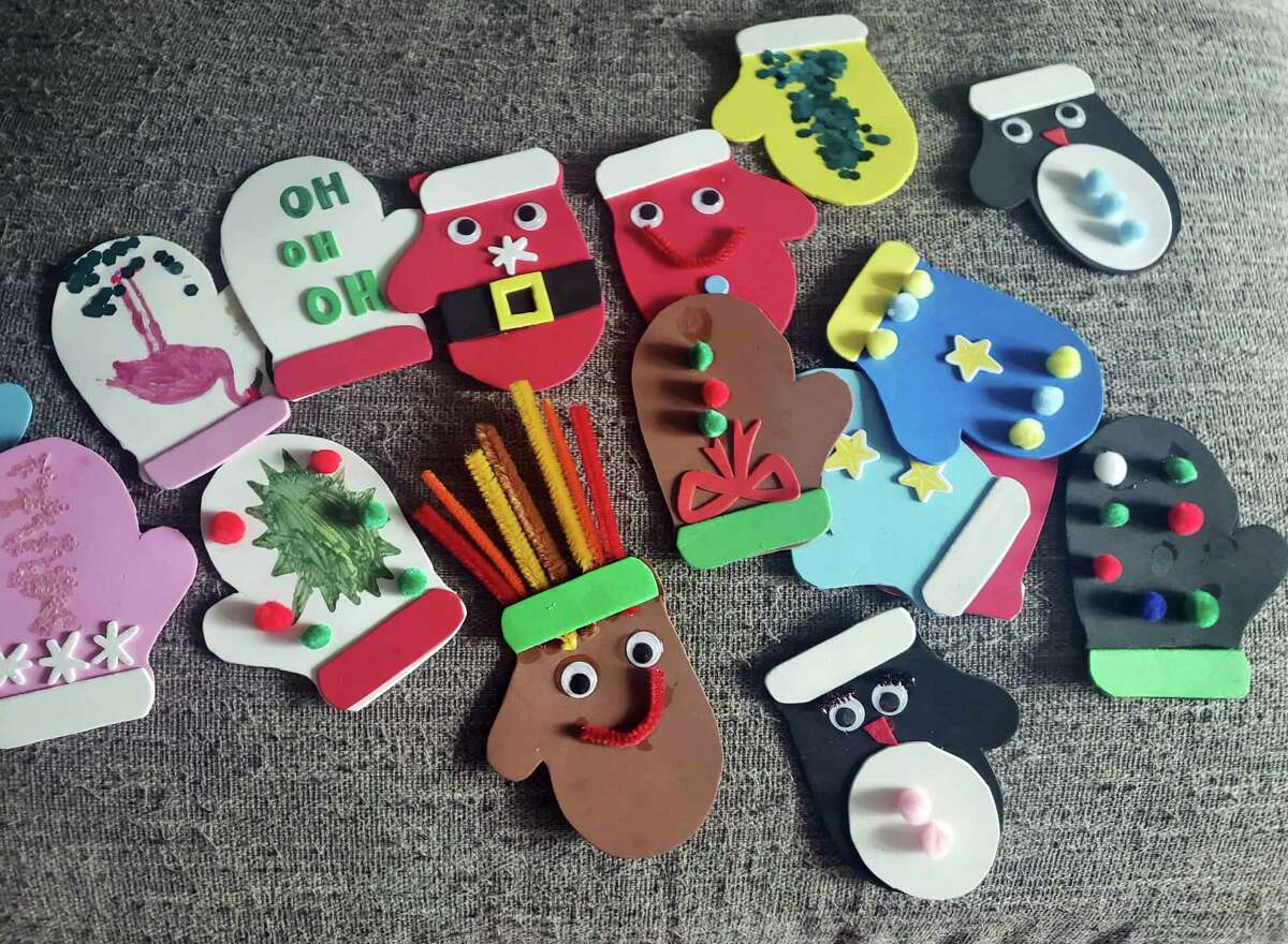 """These cute decorated cardboard """"mittens"""" have raised $900 so far."""