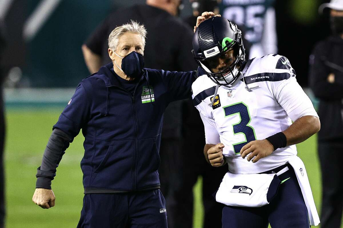 PHILADELPHIA, PENNSYLVANIA - NOVEMBER 30: Pete Carroll taps Russell Wilson #3 of the Seattle Seahawks during warm ups against the Philadelphia Eagles at Lincoln Financial Field on November 30, 2020 in Philadelphia, Pennsylvania. (Photo by Elsa/Getty Images)