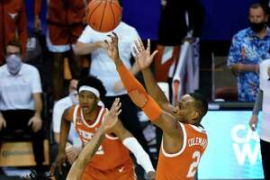Texas guard and tournament MVP Matt Coleman puts up the winning basket in the 17th-ranked Longhorns' 69-67 victory over No. 14 North Carolina in the championship game of the Maui Invitational, which was moved this year to Asheville, N.C.