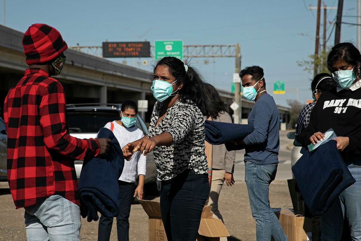 In December, Kelseyann Chorath with the San Antonio Indian Nurses Association handed out blankets to people in need near a homeless camp under Interstate 37 near downtown San Antonio. On Wednesday, Feb. 2, 2021, the city hired a crew to remove the tents.
