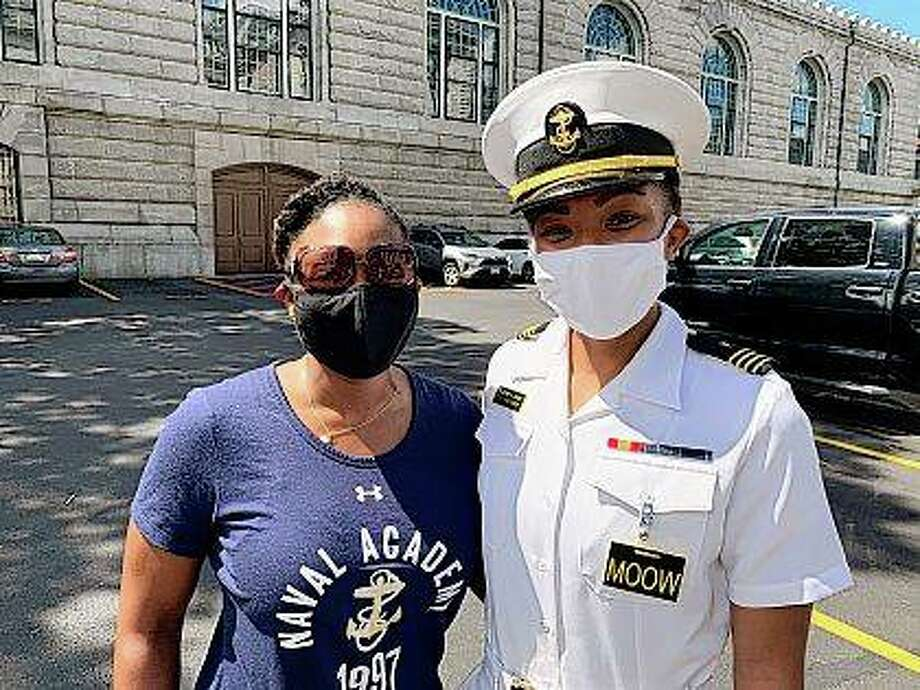 Navy Capt. Tasya Lacy (left), a 1997 graduate of the U.S. Naval Academy, stands next to Midshipman Sydney Barber on Aug. 30 in Annapolis, Maryland. Barber, a senior from Lake Forest, will be the academy's first Black woman to be the brigade commander at the academy next semester. Lacy now is legislative director for the Office of the Chief of Navy Reserve. Photo: Courtesy Of Tasya Lacy Via AP