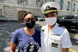 Navy Capt. Tasya Lacy (left), a 1997 graduate of the U.S. Naval Academy, stands next to Midshipman Sydney Barber on Aug. 30 in Annapolis, Maryland. Barber, a senior from Lake Forest, will be the academy's first Black woman to be the brigade commander at the academy next semester. Lacy now is legislative director for the Office of the Chief of Navy Reserve.