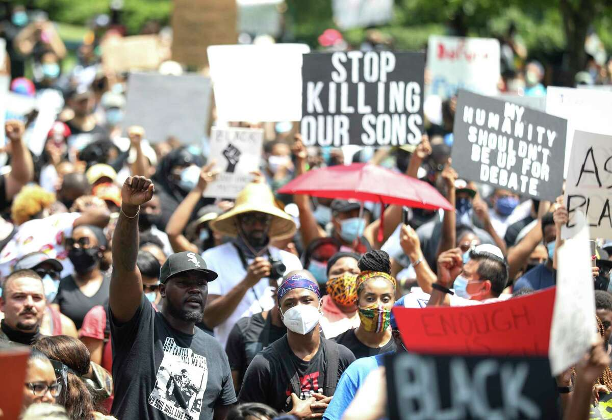 People join George Floyd's family in a march on Tuesday, June 2, 2020, from Discovery Green to City Hall in downtown Houston.