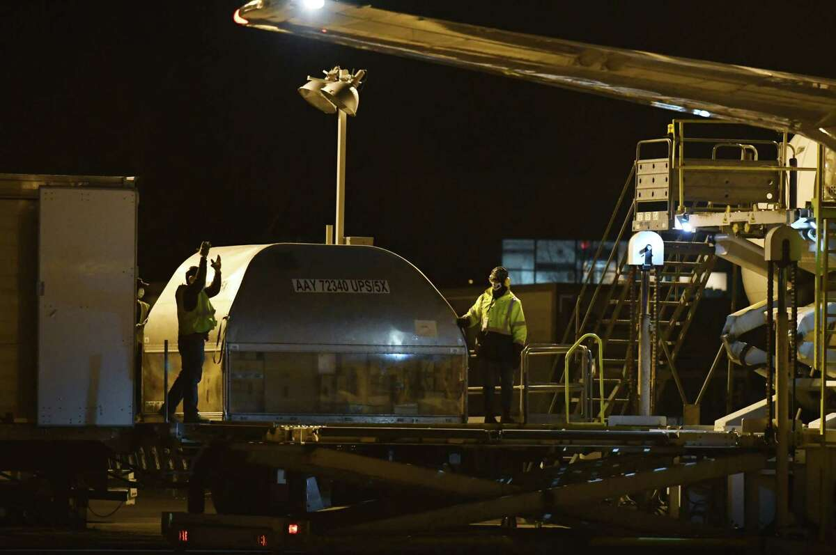 A United Parcel Service cargo plane is unloaded on Wednesday night, Dec. 2, 2020, at the Albany International Airport cargo facility in Colonie, N.Y. UPS has increased its flights into the Capital Region to handle a surge in shipments. (Will Waldron/Times Union)