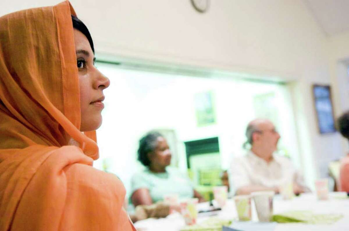 Farha Syed waits for sunset as an interfaith community gathers at the First Congregational Church on Walton Place for Iftar, an evening meal when Muslims break the Ramadan fast, Thursday, September 2, 2010. The interfaith group joined the Muslims in fasting for the day and then gathered at sunset to break the fast by first eating a date and then praying before their meal.