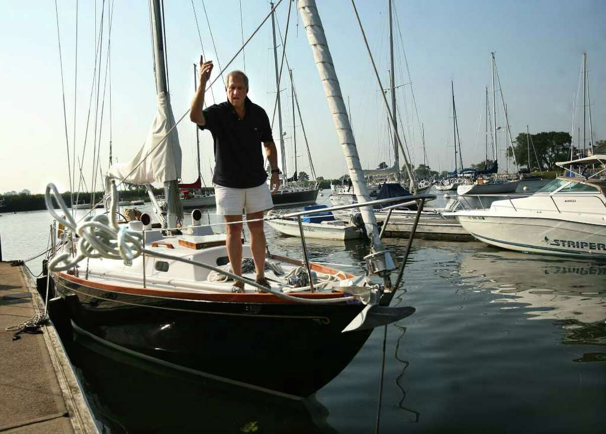 Chuck Bralver of Westport tosses a rope to the dock as he doubles up the lines securing his sailboat at the Pequot Yacht Club in Southport Harbor on Thursday, September 2, 2010.