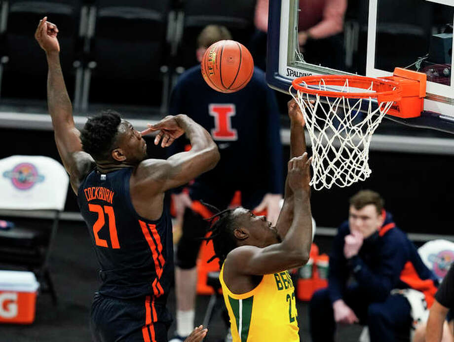 Baylor's Jonathan Tchamwa Tchatchoua has his shot blocked by Illinois' Kofi Cockburn (21) during the first half Wednesday night in Indianapolis. Photo: Associated Press