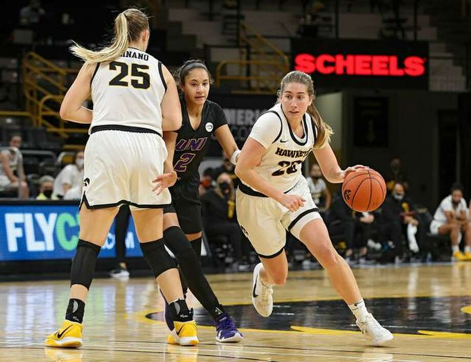 Iowa guard Kate Martin, right, drives around a pick from her teammate during her team's game against Northern Iowa.