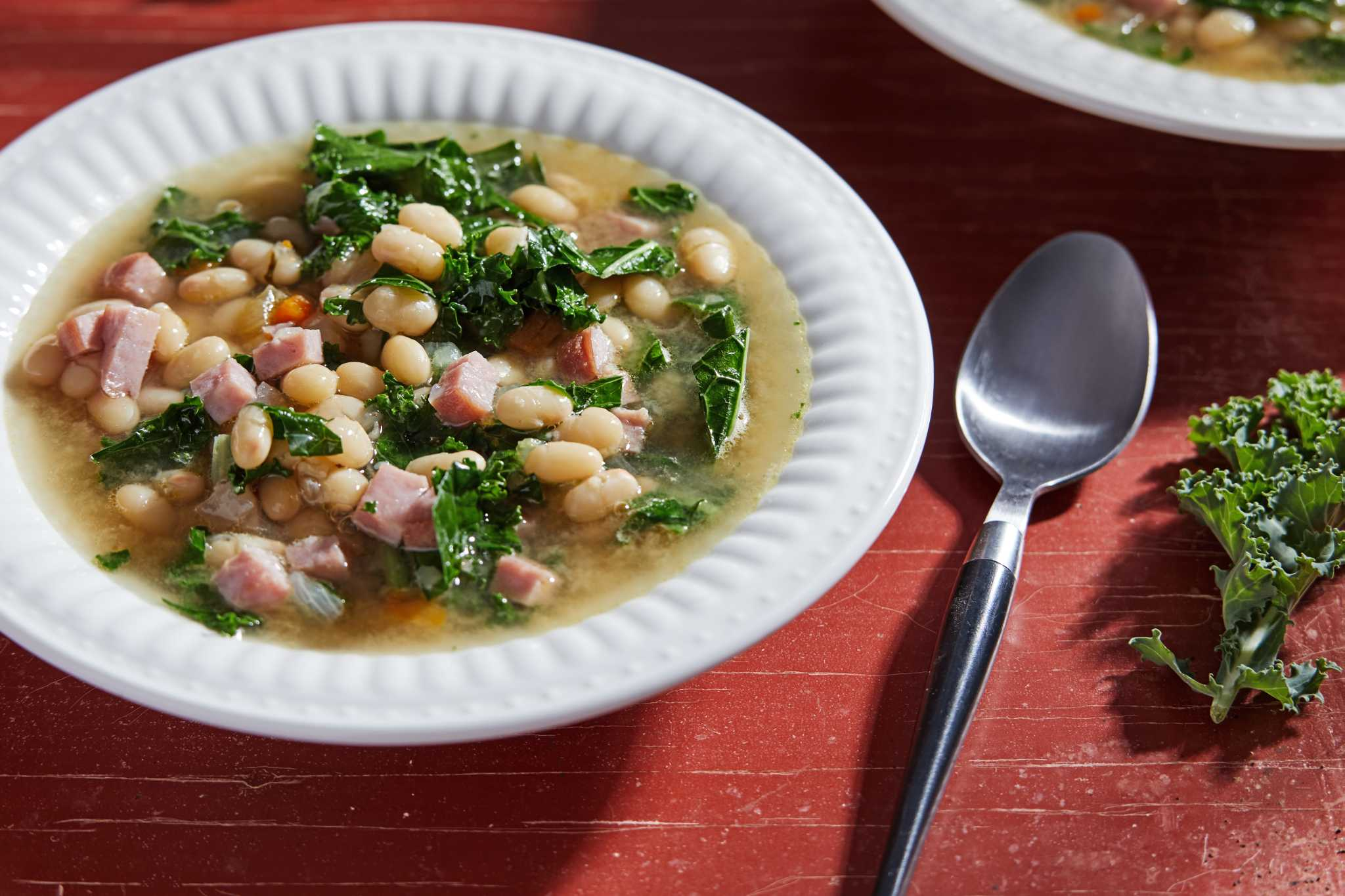 This nourishing navy bean and ham soup is a meal in a bowl