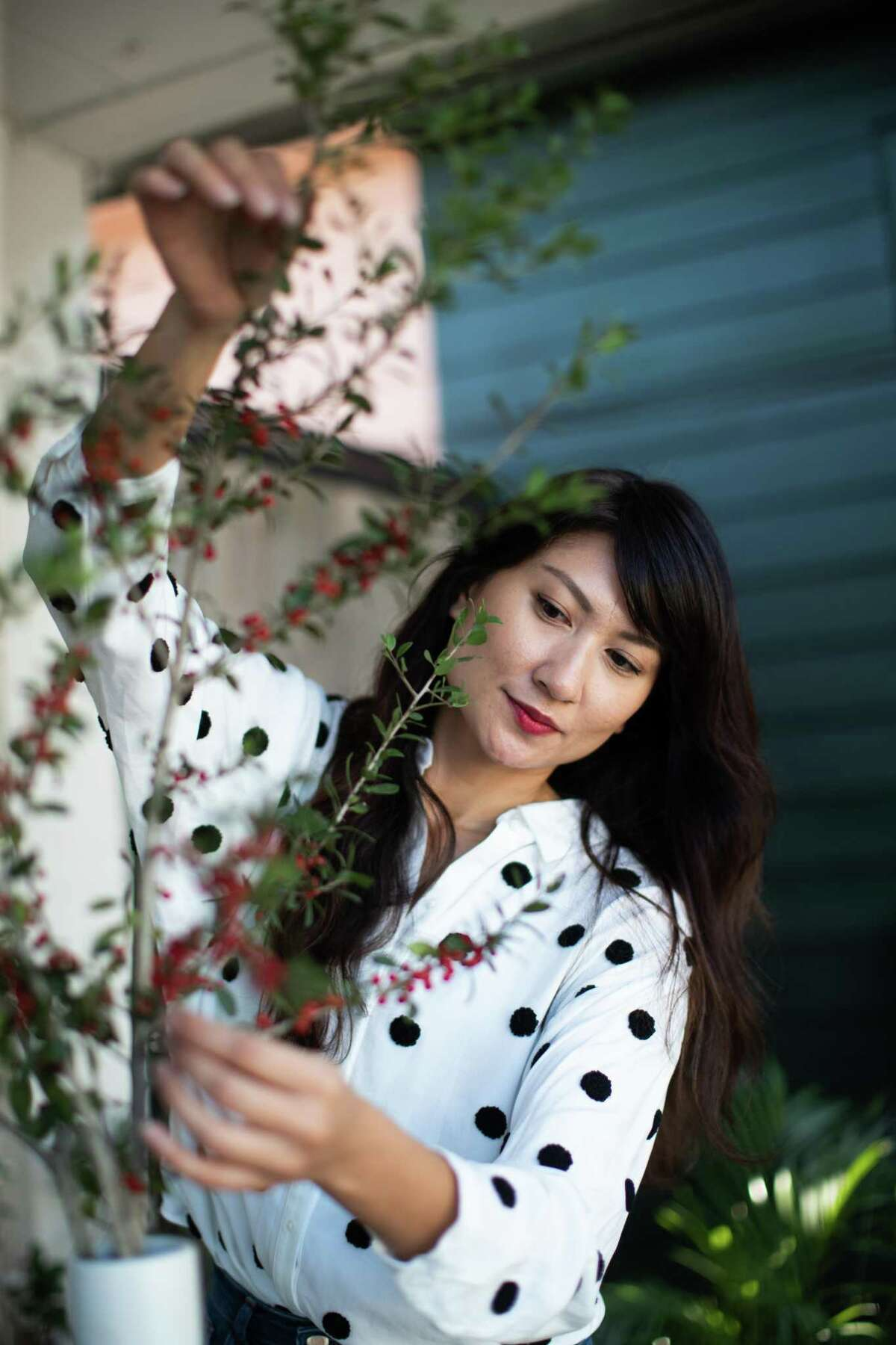 Karla Modesto, floral artist and owner of Babe City Blooms, Thursday, Nov. 12, 2020, in Houston. After getting laid off from her day job during the COVID-19 pandemic, Modesto chose to take it as an opportunity to devote herself fully to her passion: floral arrangements. She threw herself into the business, Babe City Blooms, and moved her floral wares into her friend's music store, forging a new plant and music shop on Westheimer Road, called