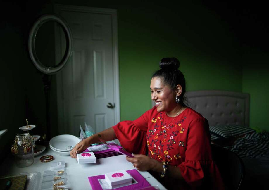 Shannen Garza Hakim, founder and owner of Womxn on the Moon at her home, Friday, Nov. 20, 2020, in Houston. Womxn on the Moon is a female focused artisan sales platform focusing on the sale of artisan jewelry. Photo: Marie D. De Jesús, Houston Chronicle / Staff Photographer / © 2020 Houston Chronicle