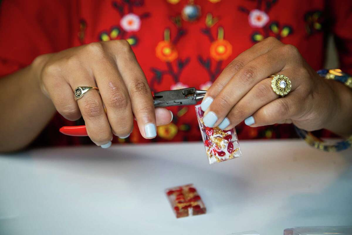 Shannen Garza Hakim, founder and owner of Womxn on the Moon at her home, Friday, Nov. 20, 2020, in Houston. Womxn on the Moon is a female focused artisan sales platform focusing on the sale of artisan jewelry.