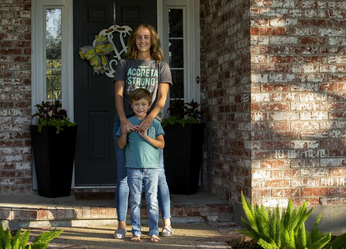 Leah Hood poses for a portrait with her 6-year-old son, Jude. When Hood was pregnant with Jude, she developed a life-threatening pregnancy complication called placenta accreta spectrum, which can cause a woman to bleed out during birth.