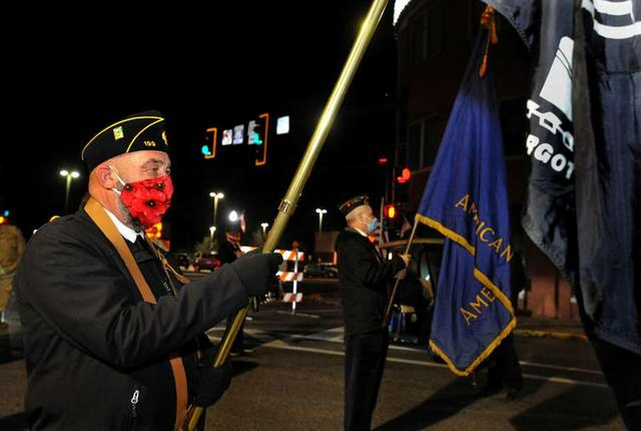 In this Nov. 11, 2020 file photo, Ed Hosto of American Legion Post 199 carries a P.O.W. flag as he participates in the Veterans Day parade on Main Street on Nov. 11 in Edwardsville. The parade, which was on a smaller scale due to COVID restrictions, is one of the few events Post 199 has been able to hold this year. Photo: Thomas Turney | For The Intelligencer