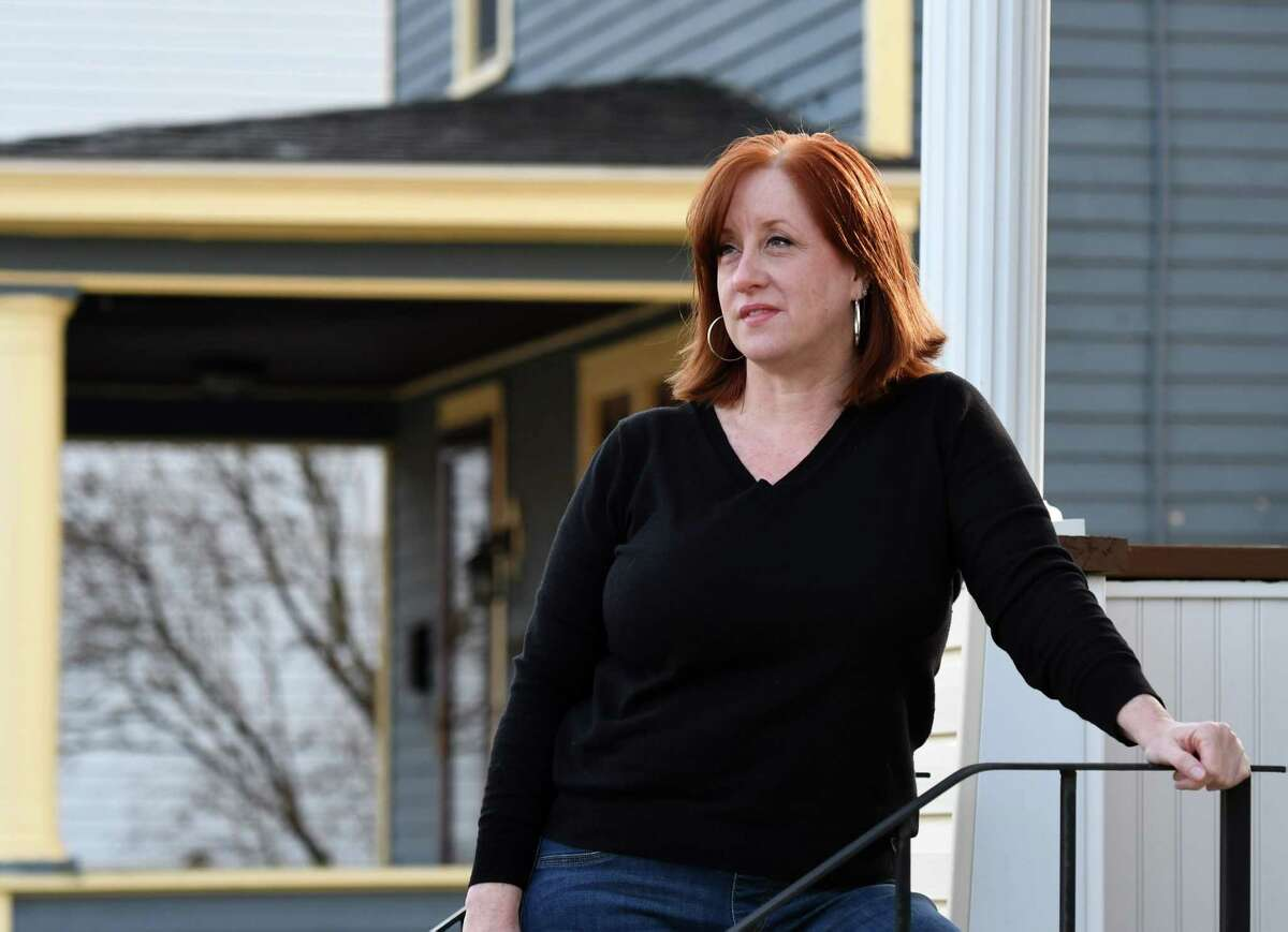 Albany County coronavirus contact tracer Lara Madison is pictured outside her home on Thursday, Dec. 3, 2020, in Watervliet, N.Y. She is one of the about 50 people in Albany County who call COVID-19 positive patients to trace who they've come in contact with. (Will Waldron/Times Union)