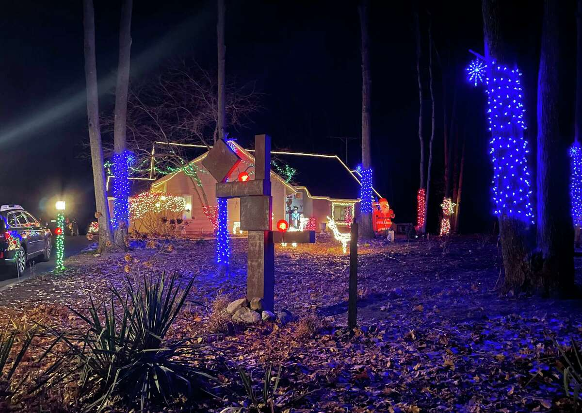The Kent family home, located at the end of Golfview Drive in Big Rapids, is displayed with all of their Christmas lights on. Renee Kent spends four days every year carefully putting each and every strain of lights up. (Pioneer photo/Bradley Massman)