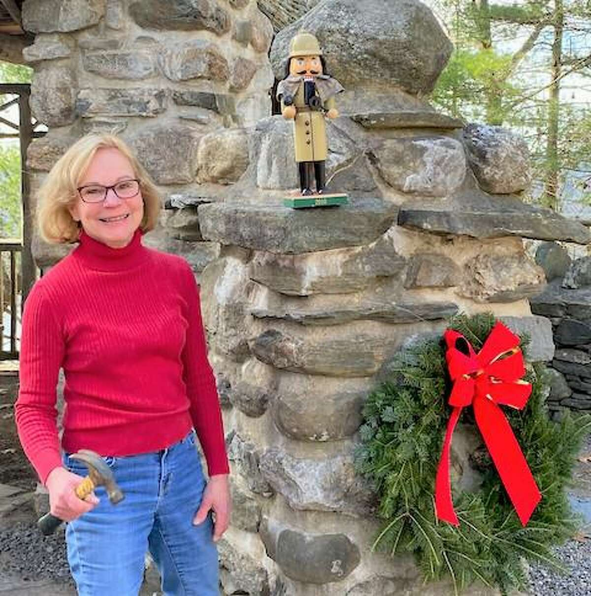 Members of the Friends of Gillette Castle State Park spent a recent weekend decorating the grounds and exterior of the late William Gillette's mansion at 67 River Road in East Haddam. Shown here is Friends members Laura Borg.