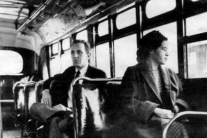 This undated file photo shows Rosa Parks riding on the Montgomery Area Transit System bus. Parks' refusal to give up her bus seat to a white man sparked the modern civil rights movement. VIA Metropolitan Transit will offer free rides all day Friday in her honor.
