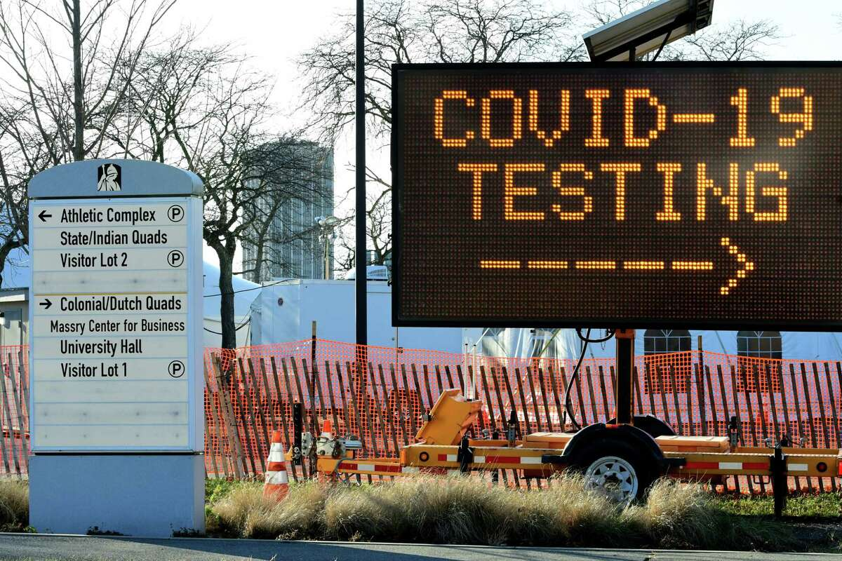 A sign directs traffic for the drive-through COVID-19 testing site at University at Albany on Thursday, Dec. 3, 2020 in Albany, N.Y. (Lori Van Buren/Times Union)