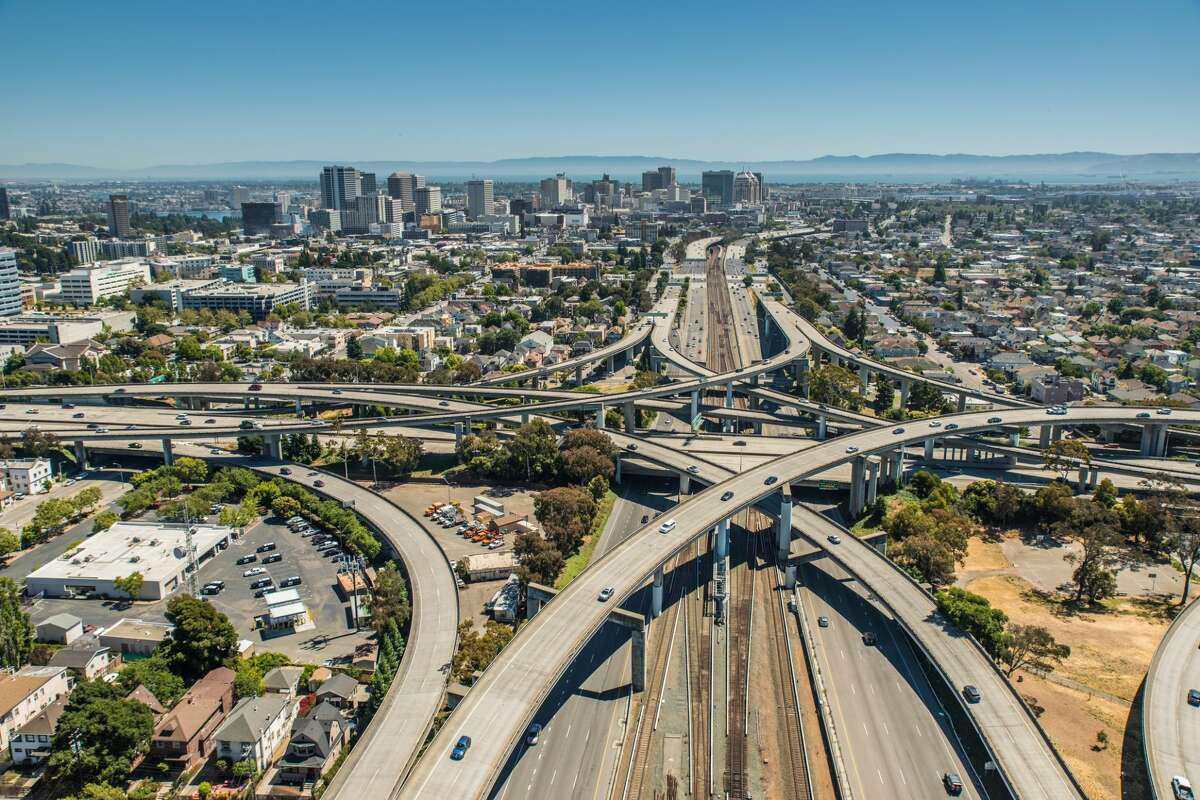 The city skyline of Oakland CA with The Maze in the foreground. The Maze is one of the largest freeway interchanges in the world.