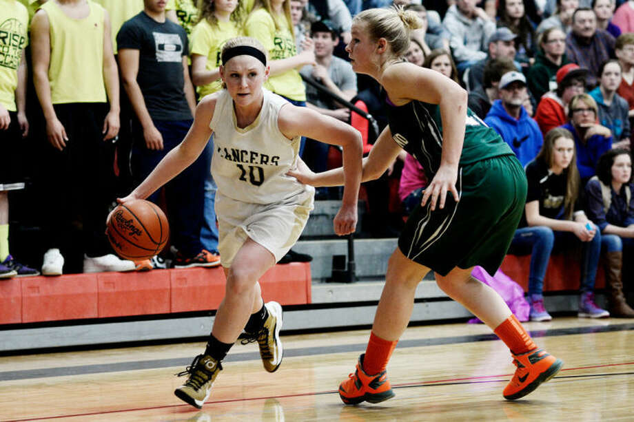 Bullock Creek's Hannah Heldt tries to turn the corner during a March 7, 2014 regional final against Freeland. Photo: Daily News File Photo