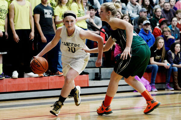 Bullock Creek's Hannah Heldt tries to turn the corner during a March 7, 2014 regional final against Freeland.