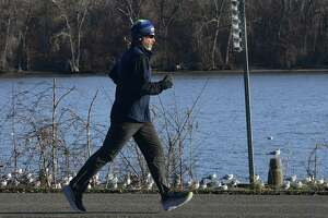 A jogger is seen making his way along the Mohawk Hudson Bike Trail near the Corning Preserve boat launch on Thursday, Dec. 3, 2020 in Albany, N.Y. (Lori Van Buren/Times Union)