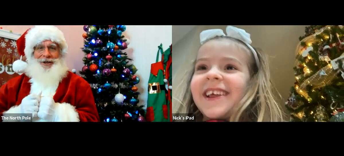 Sydney Sdoucos, 5, in Chicago enjoys a video call from Harvey Manning as Santa Claus via Virtual Santa Visits, a service based in Hondo.