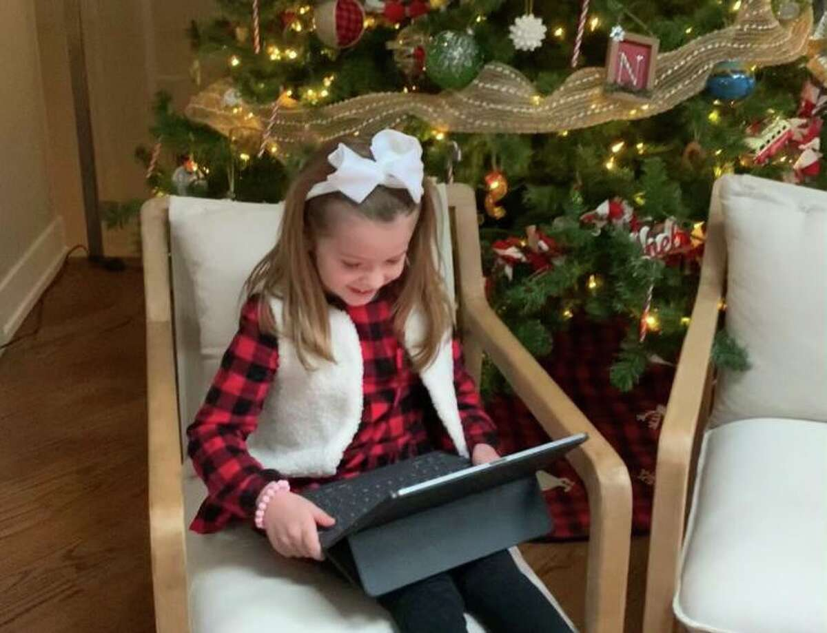 Sydney Sdoucos, 5, at her home in Chicago enjoying a video call from Harvey Manning as Santa Claus via Virtual Santa Visits, a service based in Hondo.