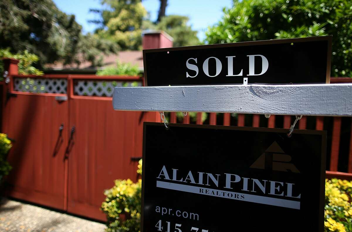 A sold sign is posted in front of a home for sale in San Anselmo, California.