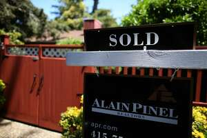 A sold sign is posted in front of a home for sale on July 22, 2015 in San Anselmo, California.