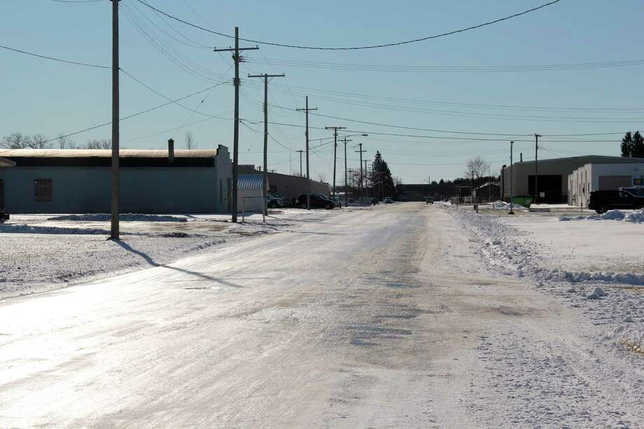 An ice-covered South Hanselman Street in Bad Axe earlier this week. The Huron County Road Commission and Michigan Office of Highway Safety Planning want resident to drive safely on roads this winter. (Robert Creenan/Huron Daily Tribune)