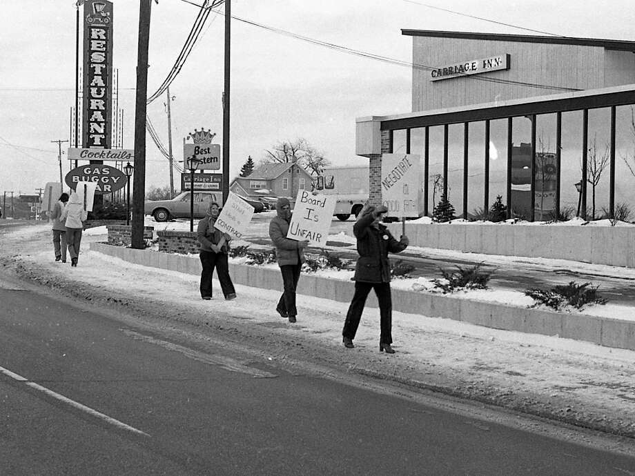 "From the front page of the Dec. 4, 1980 issue of the News Advocate, ""Members of the Manistee Intermediate School District Education Association picketed in front of the Carriage Inn whilst protesting the lack of progress in negotiations and working without a contract."" (Manistee County Historical Museum photo)"
