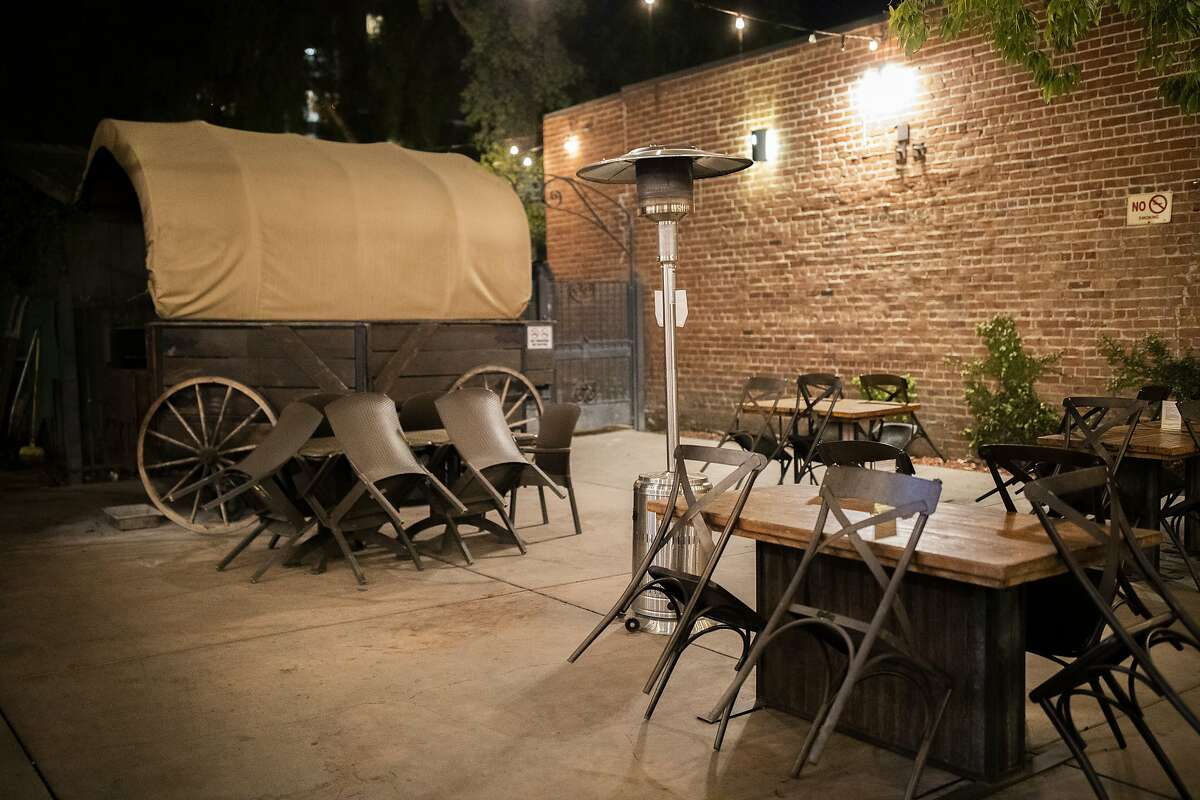 A curfew forces Old Wagon Saloon and Grill in San Jose to close up early. The restaurant may have to shut down its outdoor dining area entirely under Gov. Gavin Newsom's new stay-at-home order, which Newsom warned will likely hit the Bay Area in December.