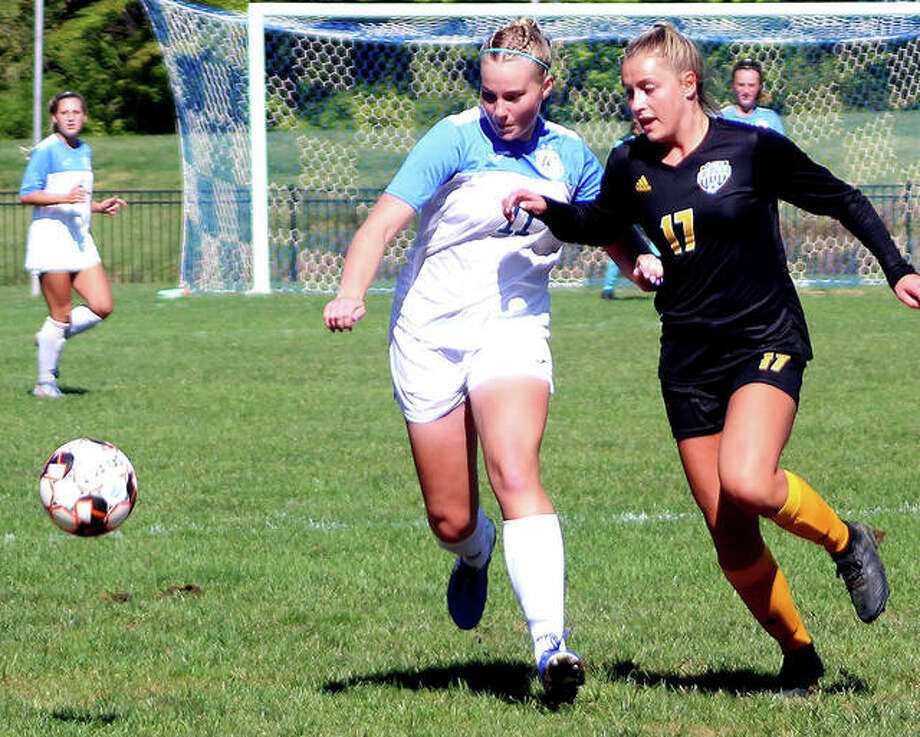 Candice Parziani of Lewis and Clark Community College, left, battles for the ball last season against Allen County, Kansas CC. Parziani is one of three LCCC kickers who will play at UMSL in the fall of 2021. Photo: Pete Hayes | The Telegraph