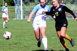 Candice Parziani of Lewis and Clark Community College, left, battles for the ball last season against Allen County, Kansas CC. Parziani is one of three LCCC kickers who will play at UMSL in the fall of 2021.