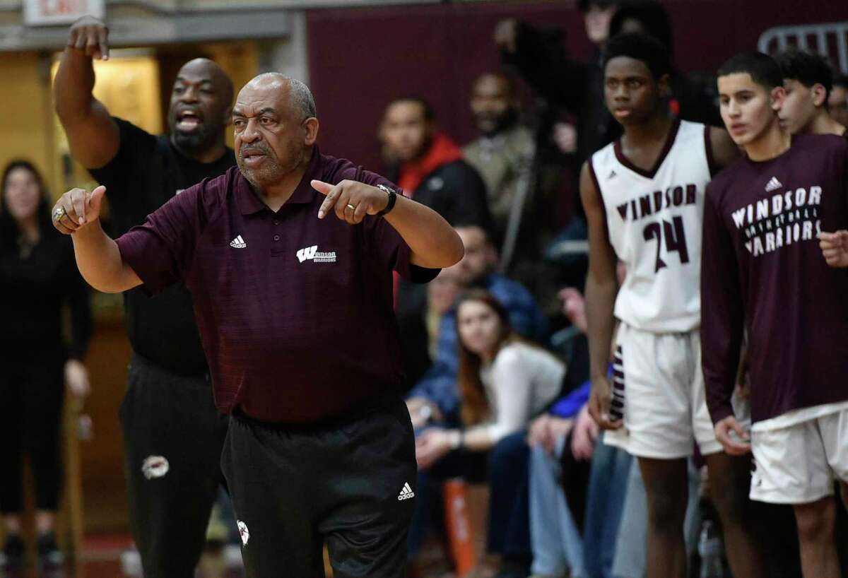 Windsor, Connecticut - January 28, 2020: Windsor boys basketball coach Ken Smith provides direction vs. East Catholic at Windsor. Final: #2 Windsor H.S. defeats #1 East Catholic H.S. 48-45.
